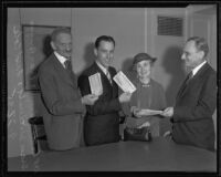 Fred Cole awards checks to sweepstakes winners Dr. Albert E. Finn, Evan Briggs, and Grace Witherill, Los Angeles, 1935