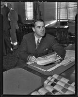 Ken Maynard, reviews documents in court, Los Angeles, 1935