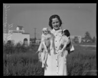 Mercedes Hill holding Japanese spaniels at the county fair dog show, Pomona, 1935