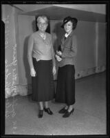 Nettie Yaw stands with Helen Hedges, who pleaded guilty to second-degree burglary, Los Angeles, 1935