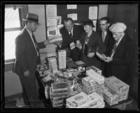 Sheriff Frederick P. Dickerson shows stolen goods to H. L. Sisley, Ray Greeley, Mrs. L.E. Armstrong, and George Morrison, Florence, 1935