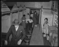 Police raid beer parlor on New High Street, Los Angeles, 1935