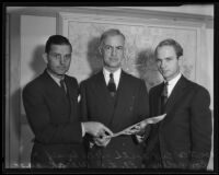 Lieutenant Colonel Earl North, Lieutenant Colonel Donald H. Connolly, and Lieutenant L. R. Wirak review paperwork for the WPA, Los Angeles, 1935