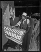 Charles M. Fuller and Harry Lee Martin examine the new Fuller Gold Dredge, Bakersfield, 1935