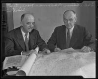 Oliver P. Adams and Harry Lee Martin examine a map for gold dredging, Bakersfield, 2915