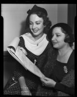 Actress Alice Moore with and her mother, Alice Joyce, look at Ms. Moore's acting  contract, Long Beach, 1935