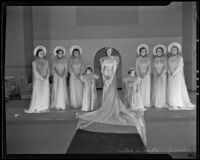 Women and girls dressed as bridal party at fashion show, 1935