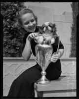 Mary Bovard with dog and trophy, Los Angeles, 1935
