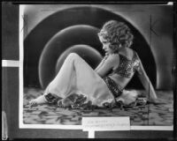 Child dancer, Mary Lou Weaver, poses reclining [rephotographed], Los Angeles, 1935
