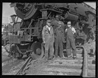 Locomotive engineers and firemen at railroad crash site, Glendale, 1935