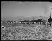 Distant view of bystanders looking on railroad accident, Glendale, 1935