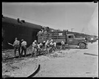Workers clean up aftermath of railroad crash, Glendale, 1935