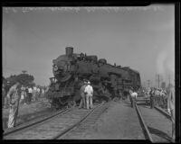 Spectators look on railroad wreckage, Glendale, 1935