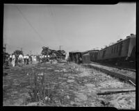 Distant view of derailed train burrowed in ground in aftermath of collision, Glendale, 1935