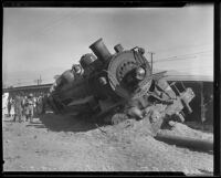 Close-up of derailed engine half-buried in ground and other train cars, Glendale, 1935