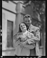 Newlyweds, Onslow Stevens and Phyllis Cooper embrace for publicity shot, Los Angeles, 1934