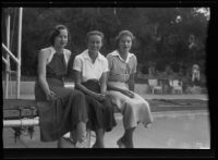 Elsie Kellogg, Jean Kennedy, and Elinor Jordan lounge on a diving board pool, Pasadena, 1935