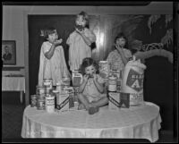 Little girls with donated goods at the Los Angeles Orphans' Home Society, Los Angeles, 1935