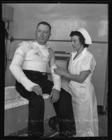 Patient G. R. Traub, nurse Grace Burge at Georgia Street Receiving Hospital, Los Angeles, 1935