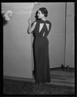 Woman models a dark, satiny dress the Times' fashion show, Los Angeles, 1935