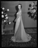 Actress Louise Brien models a white dress at a Times' fashion show, Los Angeles, 1935