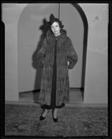 Woman models fur coat at the Times' fashion show, Los Angeles, 1935