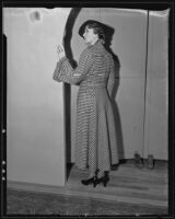 Woman models checkered coat at the Times' fashion show, Los Angeles, 1935