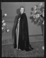 Actress Louise Brien models a long cape at a Times' fashion show, Los Angeles, 1935