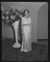 Woman models Grecian-style dress at the Times' fashion show, Los Angeles, 1935