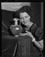 Geneva Shimp poses with ancient Egyptian glassware at the Natural History Museum, 1935