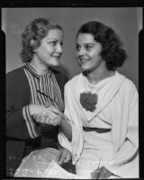 Young actresses Betty Burgess and Olympe Bradna shake hands, Los Angeles, 1935