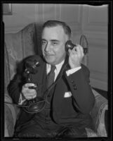 Lawyer Elisha Hanson holds phone to ear, Los Angeles, 1935