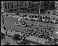Salvation Army parade procedes outside the old State Building on Spring St., Los Angeles, 1935