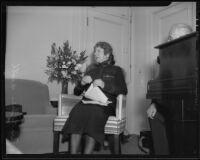 Evangeline Booth, in her Salvationist uniform, sits next to unidentified man, Los Angeles, 1935