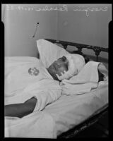Manslaughter suspect Crespin (or Crispin) Rosales in a hospital bed, Los Angeles, 1935