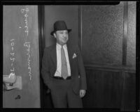 Realty racketeering criminal Louis Berman stands outside courtrooom, Los Angeles, 1935
