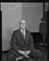 Los Angeles Times illustrator Charles Owens sits gazing into camera, Los Angeles, 1935
