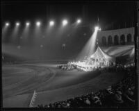 Costumed shriners, stage, and spectators at Los Angeles Memorial Coliseum, 1935