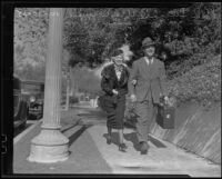 Gordon Jones and Lucile Van Winkle, walking hand-in-hand after announcing their engagement, Los Angeles, 1935