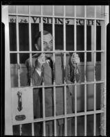 H. H. Van Loan bares his teeth in jail, Los Angeles, 1934