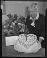 Judge Oda Faulconer cutting her birthday cake, Los Angeles, 1935