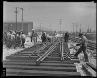 Workers lay tracks at new Union Station terminal, Los Angeles, 1938
