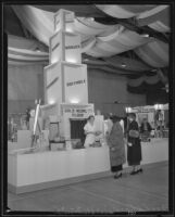Women stand in front of a display at the Food and Household Show, Los Angeles, 1935