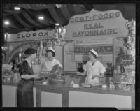 Three women at the Best Food display at the Food and Household Show, Los Angeles, 1935