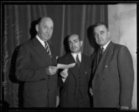 Howard S. Dudley, Tom May, and W. A. Holt raise money on behalf of the Community Chest, Los Angeles, 1935