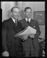 A. Felix Du Pont, Jr., conducts business with the help of C. J. Manning, Los Angeles, 1935