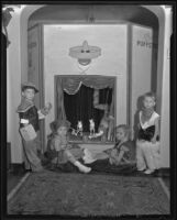Children at a Halloween party playing with puppets, Los Angeles, 1935