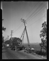 Workers remove high tension wires at Mines Field, Inglewood, 1935