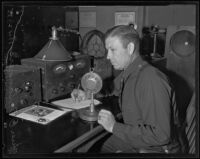 Officer Orley O. Sanner listens to police radio, Los Angeles, 1935