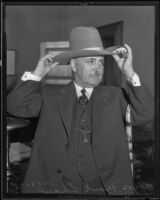 Mayor Frank Shaw adjusts his ten-gallon hat, Los Angeles, 1935